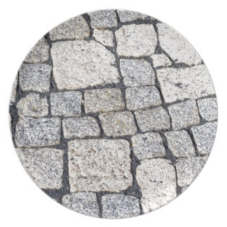 Cobblestones of a street in detail plates