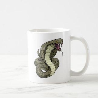 Cobra snake about to strike coffee mug