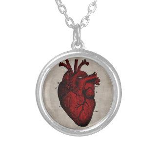 Coeur humain pendentif rond