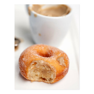 Coffee and a donut for breakfast. postcard