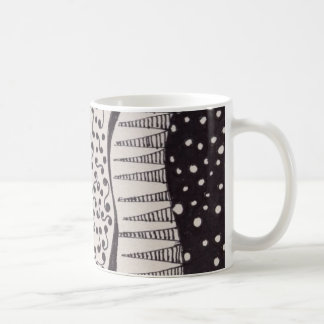 Coffee mug with black and white drawing
