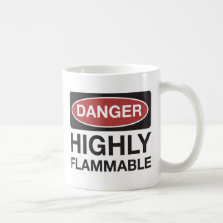 "Coffee mug with ""Danger Highly Flammable"" signage"