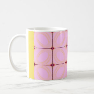 Coffee mug with eclectic  pink and yellow design.