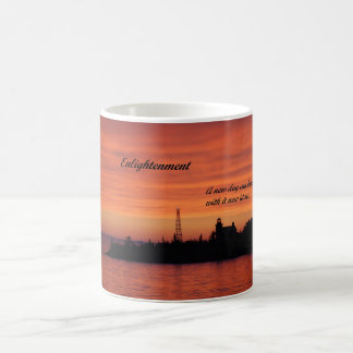 Coffee mug with picture of light house at sunrise.