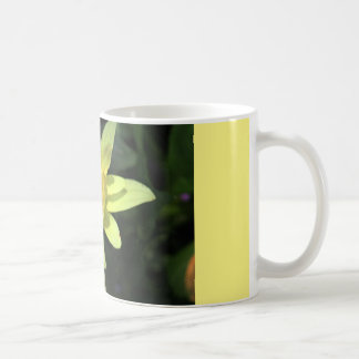 coffee mug with yellow wild flower