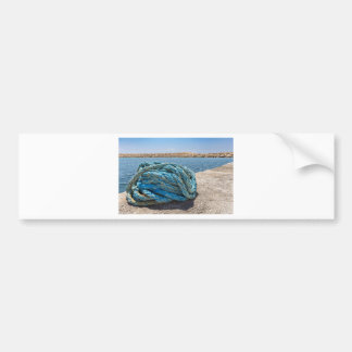 Coiled blue mooring rope at water in greek cave bumper sticker