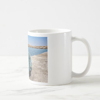 Coiled blue mooring rope at water in greek cave coffee mug