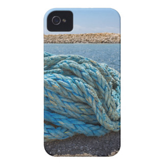Coiled blue mooring rope at water in greek cave iPhone 4 Case-Mate cases