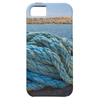 Coiled blue mooring rope at water in greek cave iPhone 5 cases