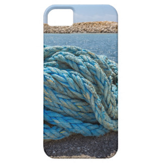 Coiled blue mooring rope at water in greek cave iPhone 5 cover