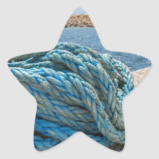 Coiled blue mooring rope at water in greek cave star sticker