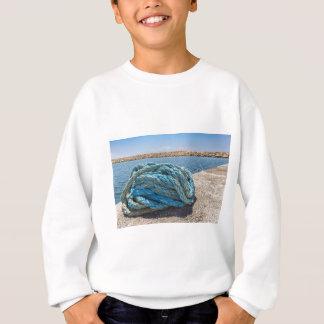 Coiled blue mooring rope at water in greek cave sweatshirt