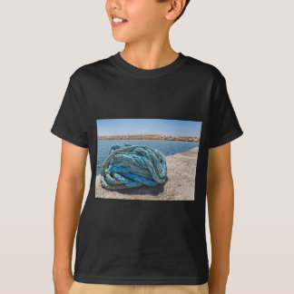 Coiled blue mooring rope at water in greek cave T-Shirt