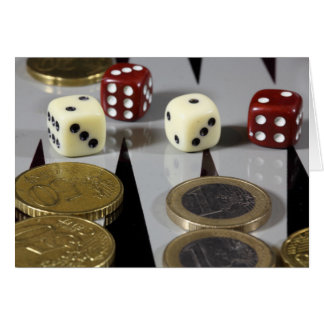 Coins on a backgammon board card