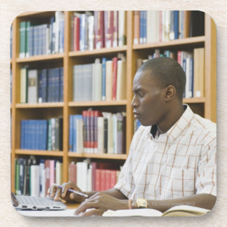 College student working in library drink coaster