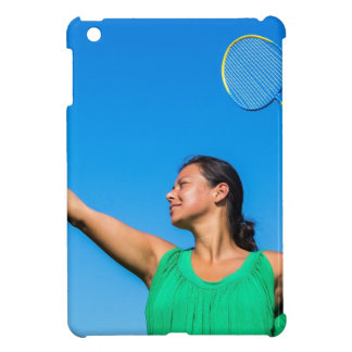 Colombian woman serve with badminton racket cover for the iPad mini