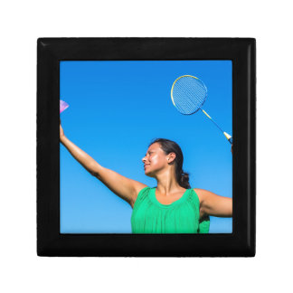 Colombian woman serve with badminton racket gift box