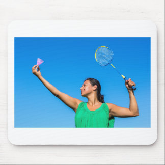 Colombian woman serve with badminton racket mouse pad