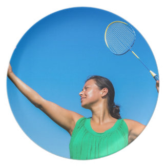 Colombian woman serve with badminton racket party plates