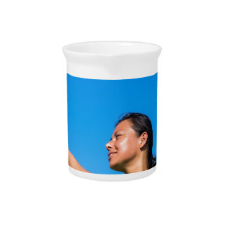 Colombian woman serve with badminton racket pitcher