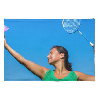 Colombian woman serve with badminton racket placemat