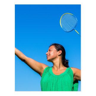Colombian woman serve with badminton racket postcard