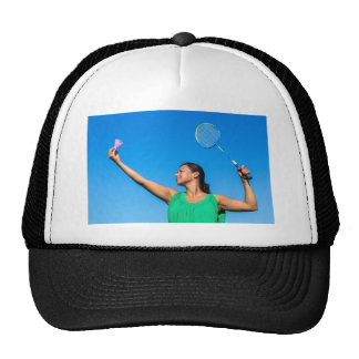 Colombian woman serve with badminton racket trucker hat