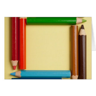 Color pencils forming a square frame card