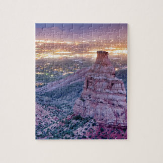 Colorado Independence Monument and City Lights Of Jigsaw Puzzle
