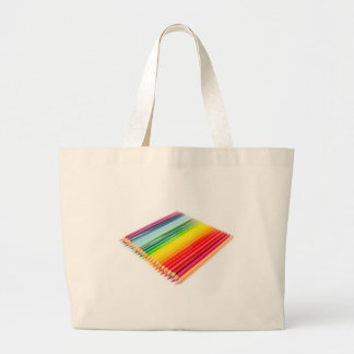 Colored crayons lying side by side large tote bag