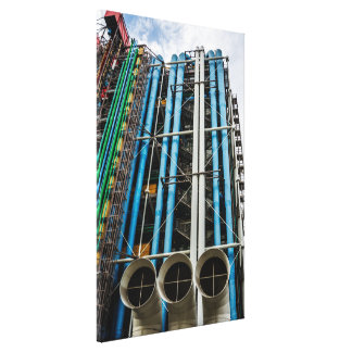 Colored pipelines on the facade of a building canvas print