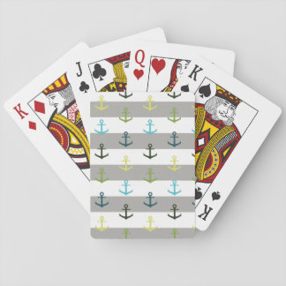 Colorful anchor pattern on stripy background playing cards