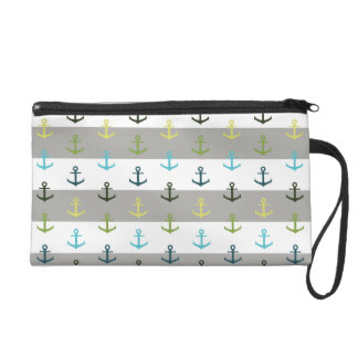 Colorful anchor pattern on stripy background wristlet