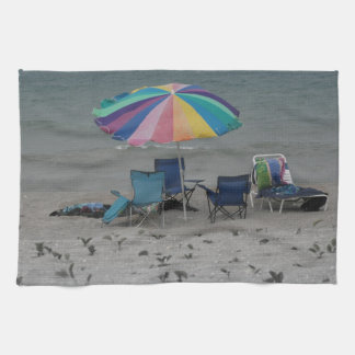 colorful beach umbrella dusty vintage style chair towels