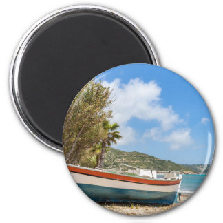 Colorful boat lying on greek beach 2 inch round magnet