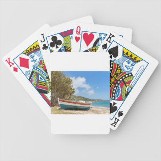 Colorful boat lying on greek beach bicycle playing cards