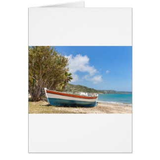 Colorful boat lying on greek beach card
