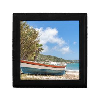 Colorful boat lying on greek beach keepsake boxes