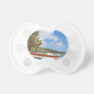 Colorful boat lying on greek beach pacifier