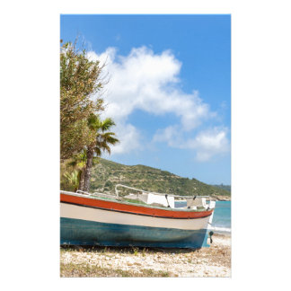 Colorful boat lying on greek beach stationery design