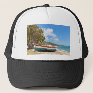 Colorful boat lying on greek beach trucker hat