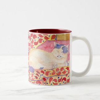 Colorful cat on sofa mug