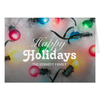 Colorful Christmas lights glowing in the snow Greeting Card