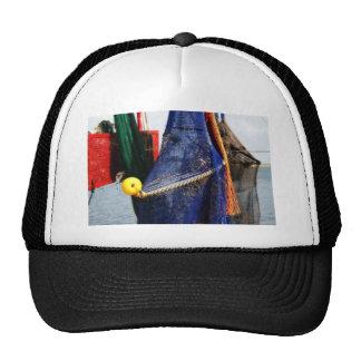 Colorful crabbing fishing nets and floats, florida mesh hats