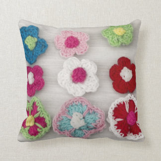 colorful crocheted flowers throw pillow