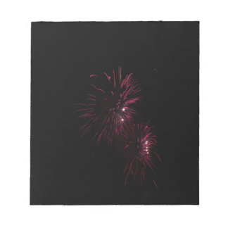 Colorful fireworks of various colors in the night notepad