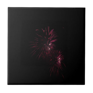 Colorful fireworks of various colors in the night tile