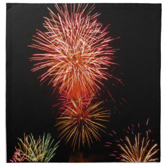 Colorful fireworks of various colors light up the napkins