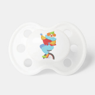 Colorful Friendly Clown Balancing On Unicycle Pacifier