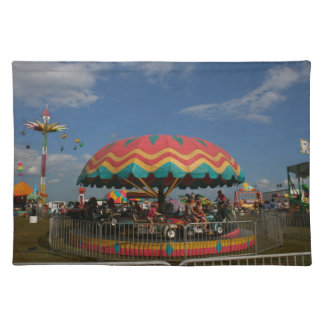 Colorful kid ride at fair place mat